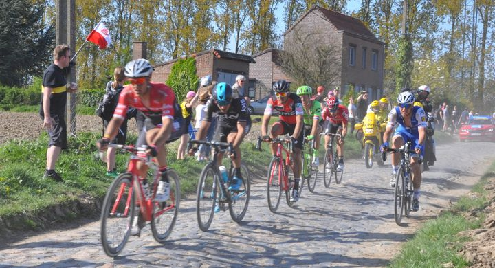 Cyclists compete in the 2017 Paris-Roubaix course.