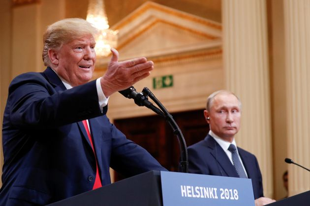 U.S. President Donald Trump gestures during a joint news conference with Russia's President Vladimir...