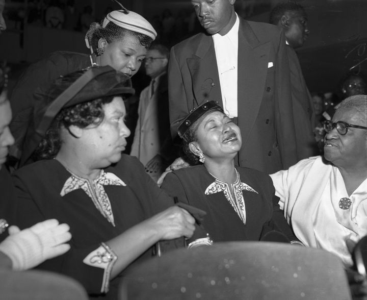 Emmett Till's mother, Mamie Bradley, sobs during his funeral service in Chicago.