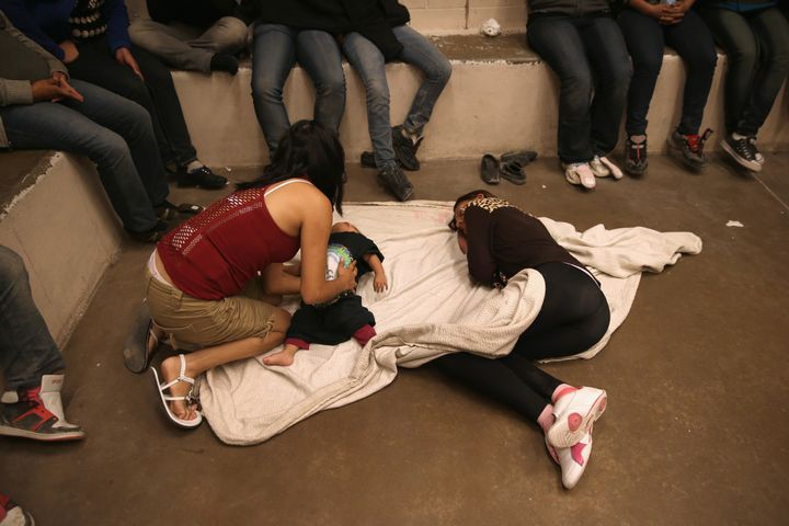 Women and children wait in a holding cell at a U.S. Border Patrol processing center on Sept. 8, 2014, near McAllen, Texas.