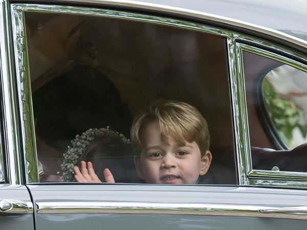 Pageboy Prince George beckons, as he celebrates the wedding of Pippa Middleton and James Matthews at St Mark's Church on May 20, 2019