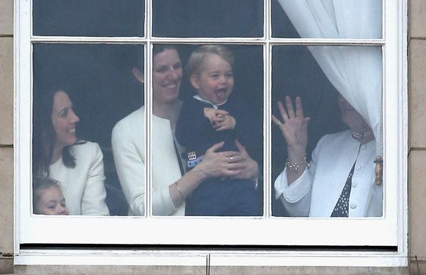 Prince George waves from the window of Buckingham Palace as he watches the Trooping the Colour on June 13, 2015, in London, E