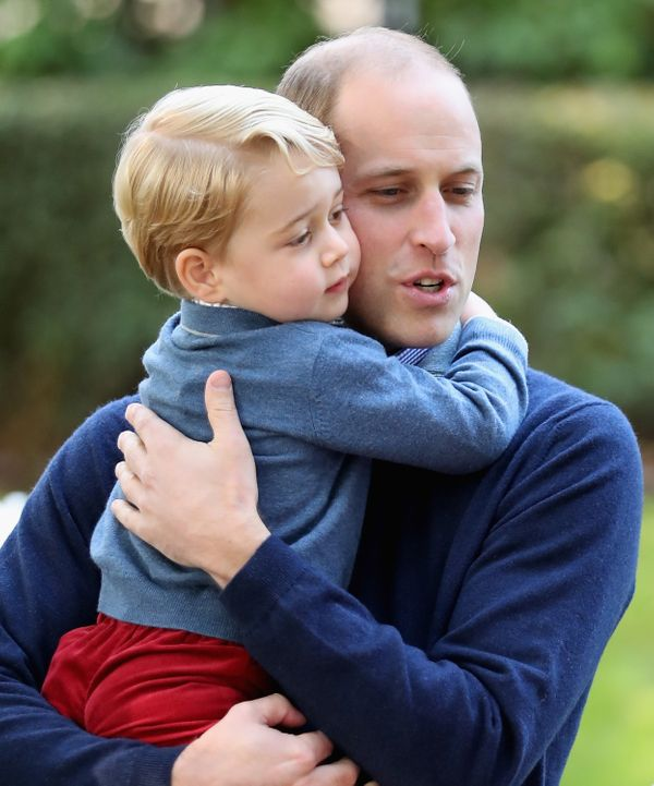 Prince George with Prince William at a children's party for military families during the Royal Tour of Canada onSept. 2
