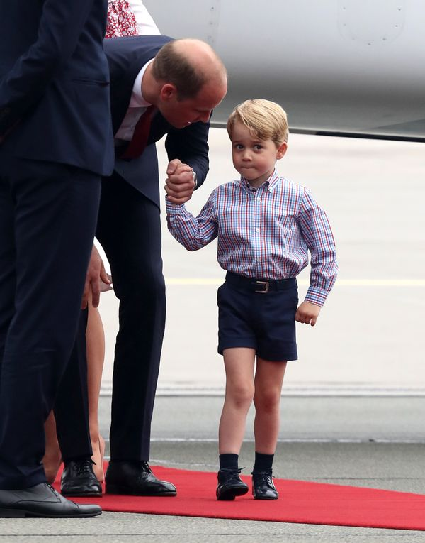 Prince William speaks with Prince George of Cambridge as they arriveon the first day oftheir official visit to Po