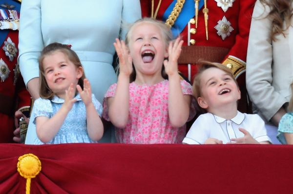 Princess Charlotte, Savannah Phillips, and Prince George watch the flypast on the balcony of Buckingham Palace during Troopin