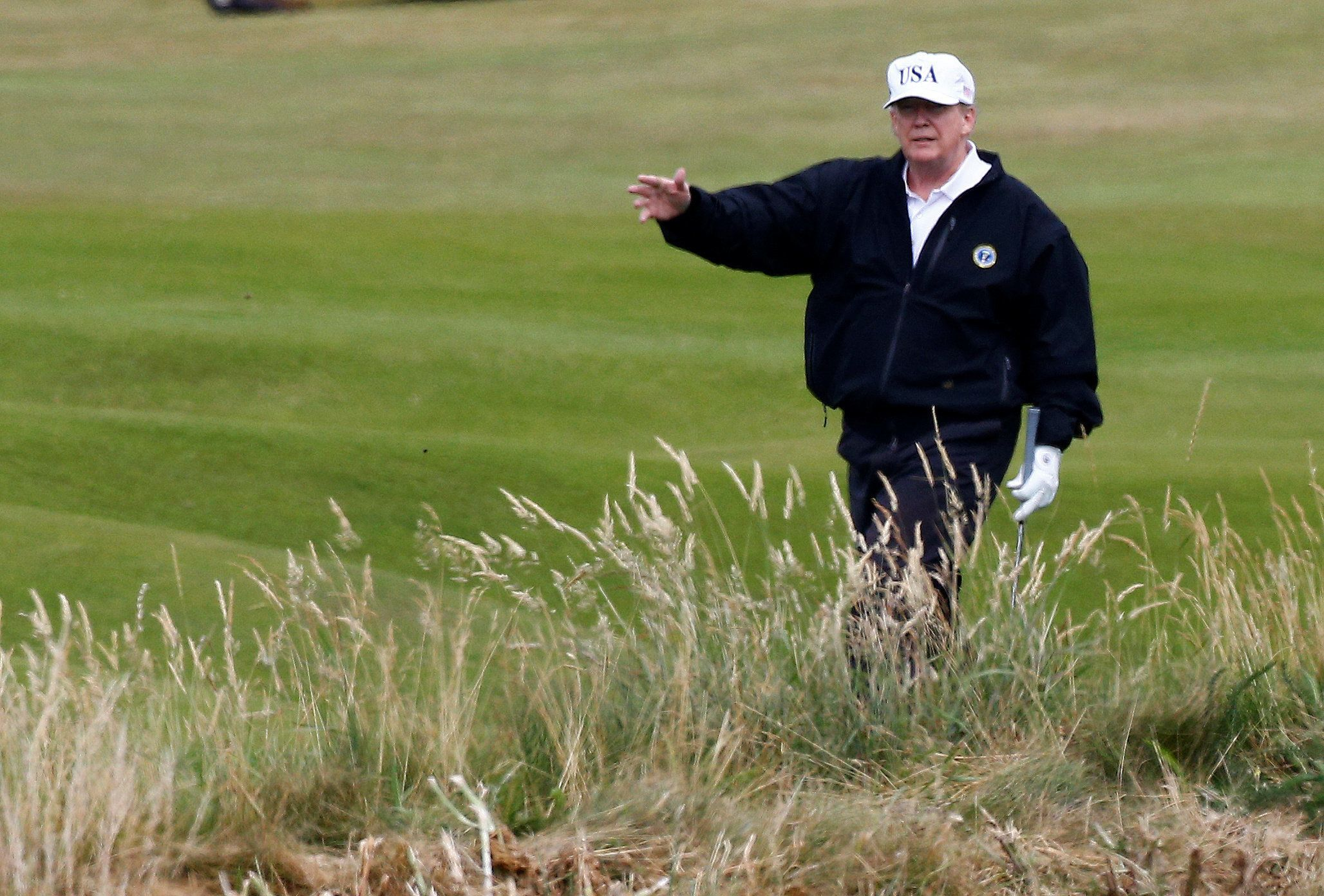 U.S. President Donald Trump gestures as he walks on the course of his golf resort, in Turnberry, Scotland  July 14, 2018.  REUTERS/Henry Nicholls