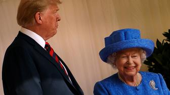 US President Donald Trump speaks with Britain's Queen Elizabeth II after he inspected the Guard of Honour at Windsor Castle in Windsor, west of London, on July 13, 2018 on the second day of Trump's UK visit. - US President Donald Trump on Friday played down his extraordinary attack on Britain's plans for Brexit, praising Prime Minister Theresa May and insisting bilateral relations 'have never been stronger', even as tens of thousands protested in London against his visit. (Photo by Brendan Smialowski / AFP)        (Photo credit should read BRENDAN SMIALOWSKI/AFP/Getty Images)