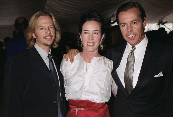 Kate Spade is flanked by her husband, Andy Spade (right) and brother-in-law David Spade at the American Fashion Awards in New