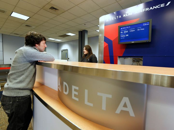 A passenger checks in at a Delta Airlines gate in Salt Lake City, Utah.