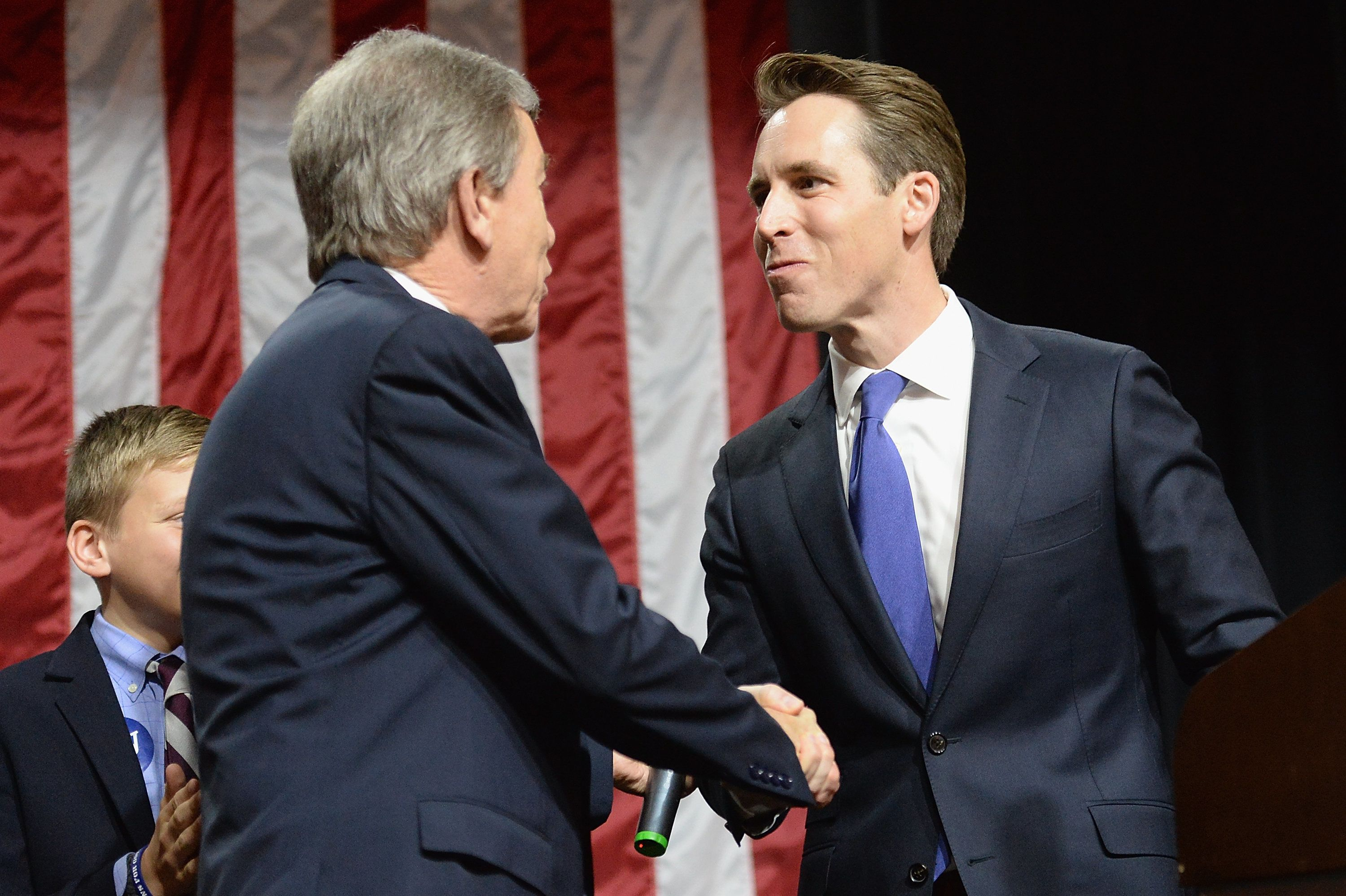 Missouri Attorney General Josh Hawley shakes hands in 2016 with GOP Sen. Roy Blunt, who he once joked about replacing.