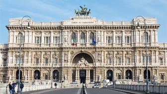 Rome, Italy - March 27, 2015: The facade of Palace of Justice - Palazzo di Giustizia designed by the Perugia architect Guglielmo Calderini and built between 1888 and 1910 and number of peoples.