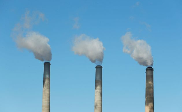 Emissions rise out of three large smokestacks at Pacificorp's coal-fired power plant in Castle Dale,...