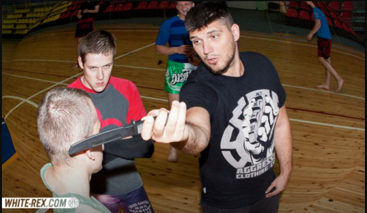 "In a post from White Rex's Tumblr, a man in a White Rex shirt gives a ""knife combat seminar."""