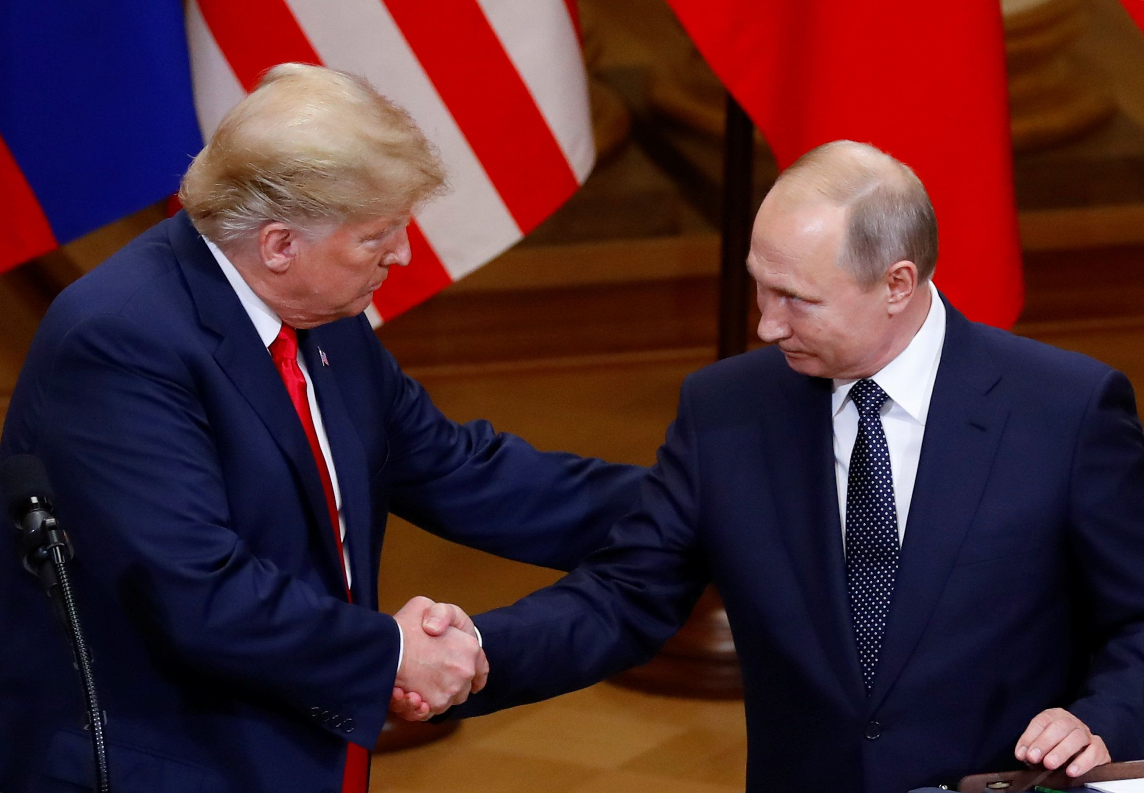 U.S. President Donald Trump and Russian President Vladimir Putin shake hands as they hold a joint news conference after their meeting in Helsinki, Finland, July 16, 2018. REUTERS/Leonhard Foeger