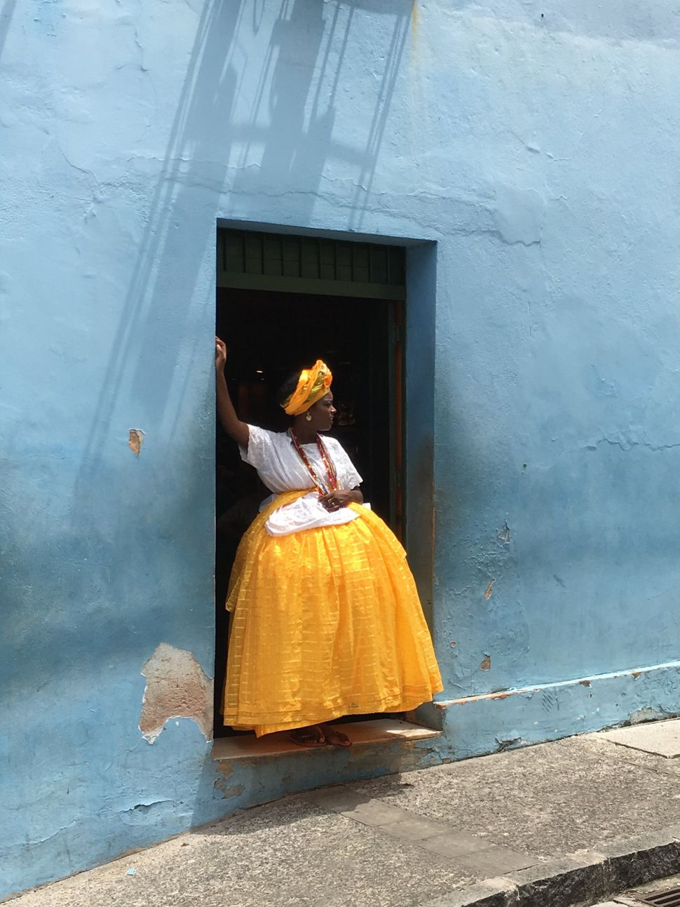 "First Place<br>""Baiana in yellow and blue""<br>The picture was taken in Salvador de Bahia, Brazil, spontaneously, after a truc"
