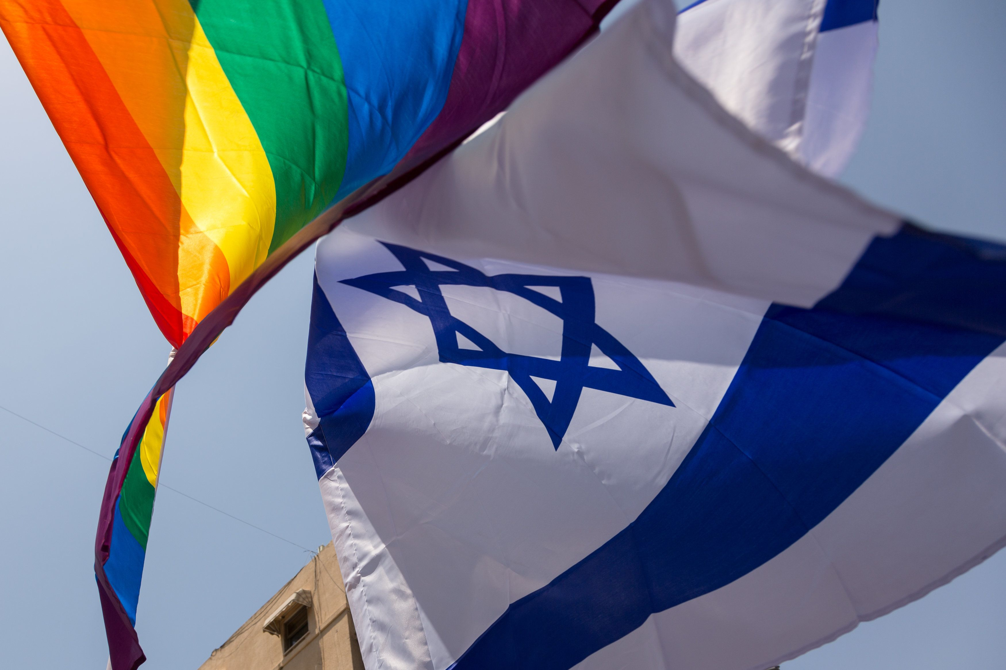 Israeli and LGBT flags during 20th Pride Parade in Tel Aviv, Israel on June 8, 2018. The beach boulevard march attracted 250 thousand people (Photo by Dominika Zarzycka/NurPhoto via Getty Images)
