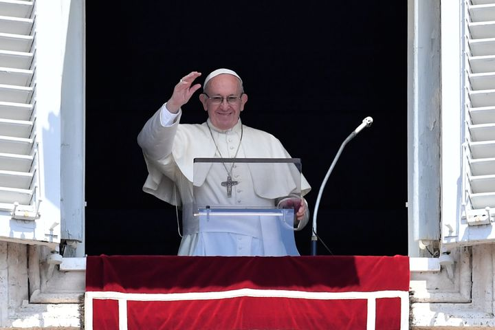 Pope Francis waves to the crowd during the Sunday Angelus prayer at the Vatican on July 15.