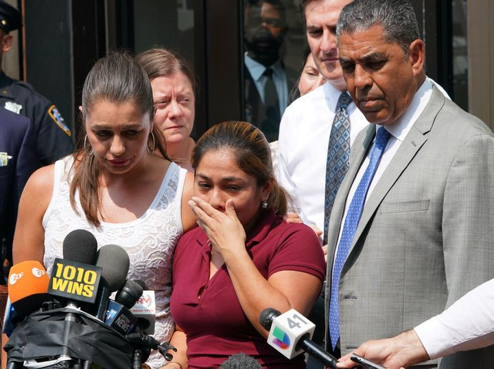 Yeni Marciela Gonzalez Garcia, center, speaks to the news media after being reunited with her children on July 13. A consider