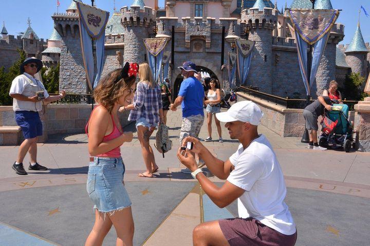 Williams got down on one knee in front of Disneyland's Sleeping Beauty Castle.