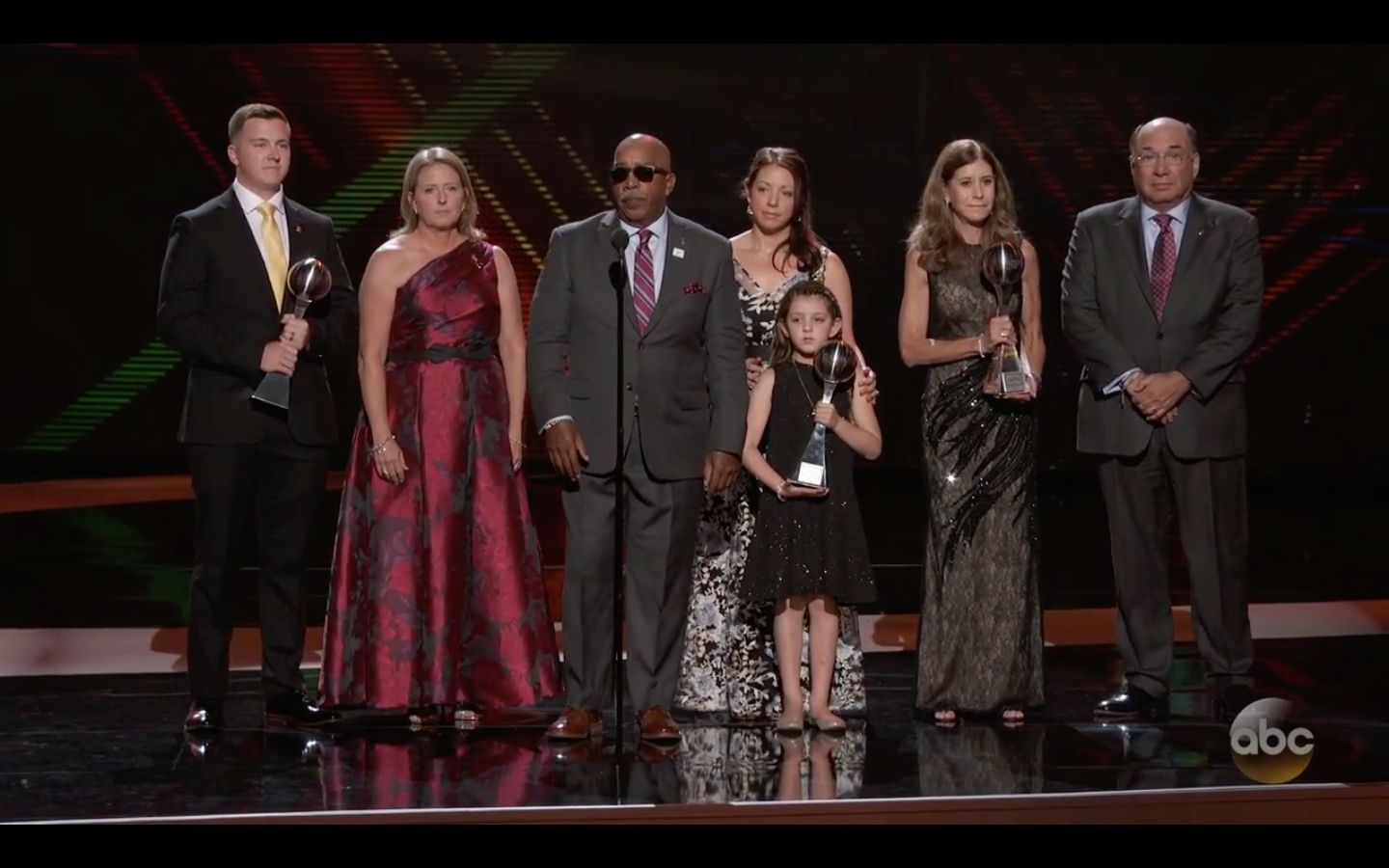 The families of Scott Beigel, Aaron Feis and Chris Hixon jointly accepted the award for Best Coach at the ESPYs.