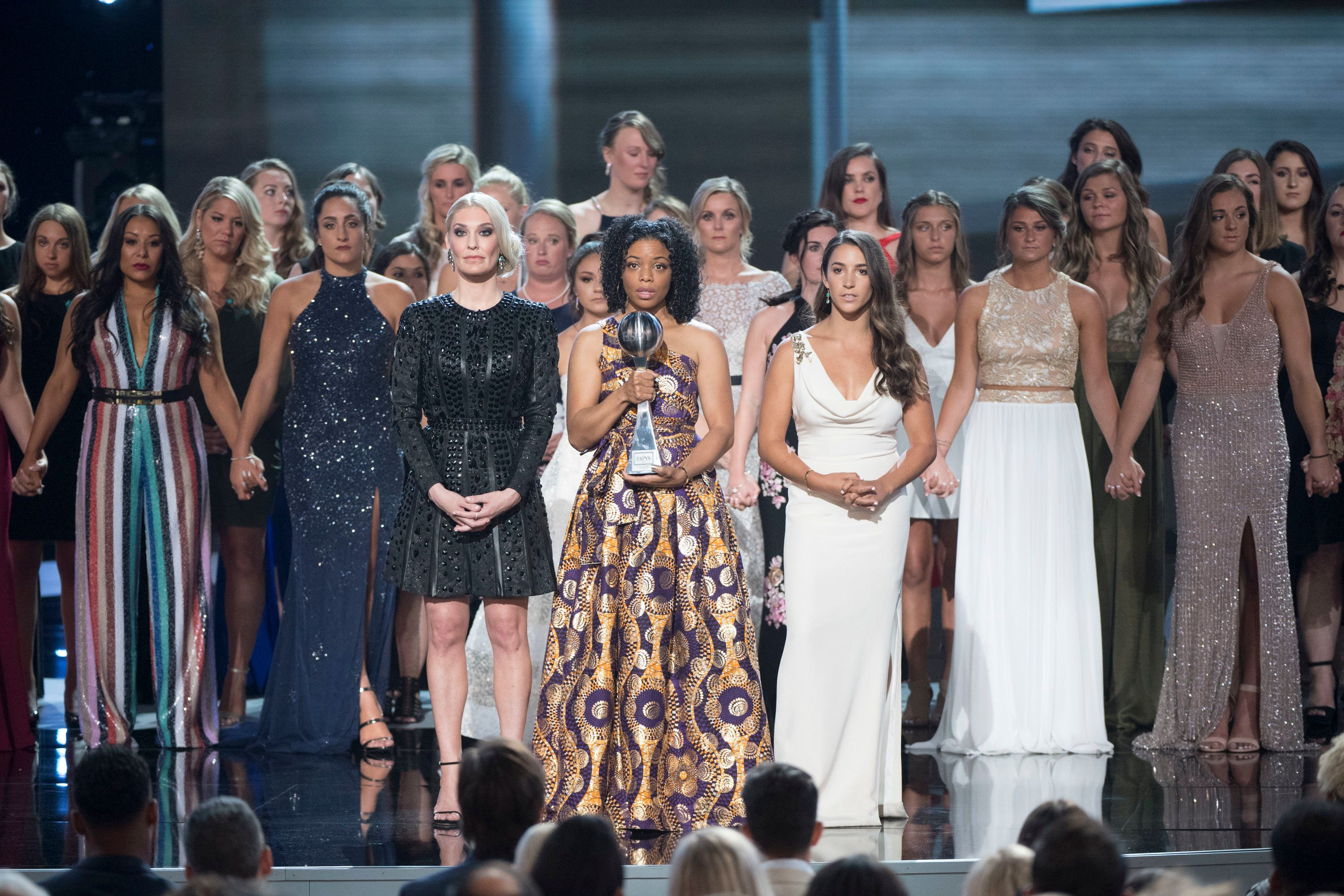 To accept the Arthur Ashe Courage Award, 141 survivors took the ESPY stage Wednesday night.