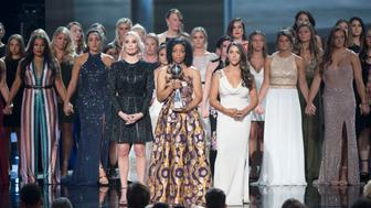 THE 2018 ESPYS - This Wednesday, the worlds best athletes and biggest stars will join host Danica Patrick for 'The 2018 ESPYS Presented by Capital One' on ABC. The star-studded evening celebrates the best moments from the year in sports and will air live on ABC, July 18 from 8:00-11:00 p.m. EDT, from the Microsoft Theater in Los Angeles. (Image Group LA via Getty Images) THE ARTHUR ASHE AWARD FOR COURAGE RECIPIENTS, SARAH KLEIN, TIFFANY THOMAS LOPEZ, ALY RAISMAN