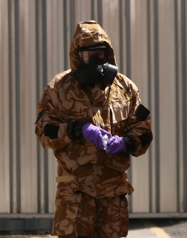 An investigator in a chemical suit works in Salisbury, following the second