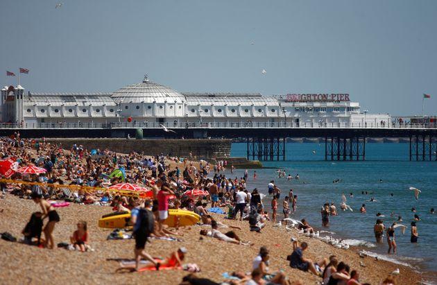 Sun worshippers enjoy Brighton beach during the