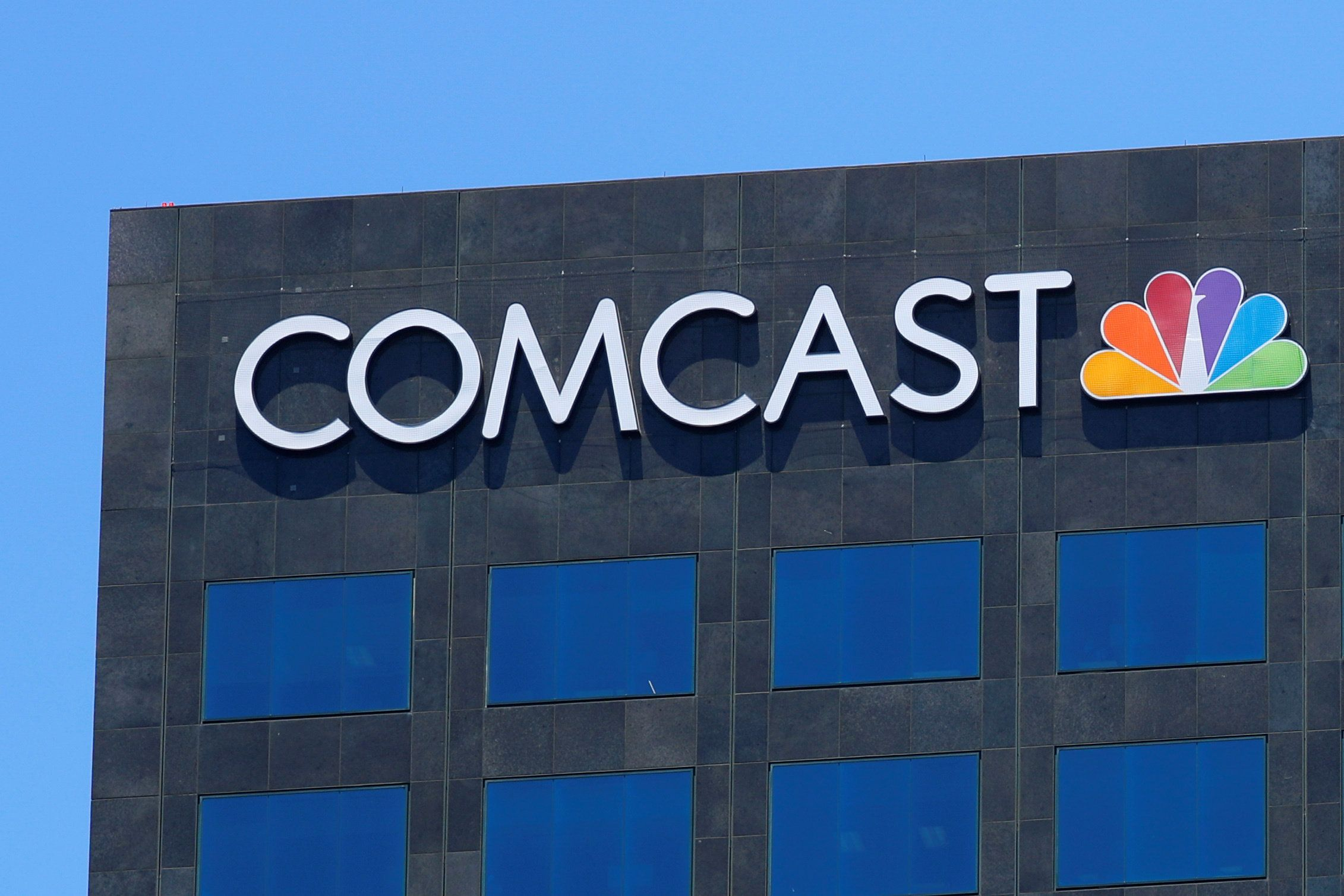 The Comcast NBC logo is shown on a building in Los Angeles, California, U.S. June 13, 2018.        REUTERS/Mike Blake