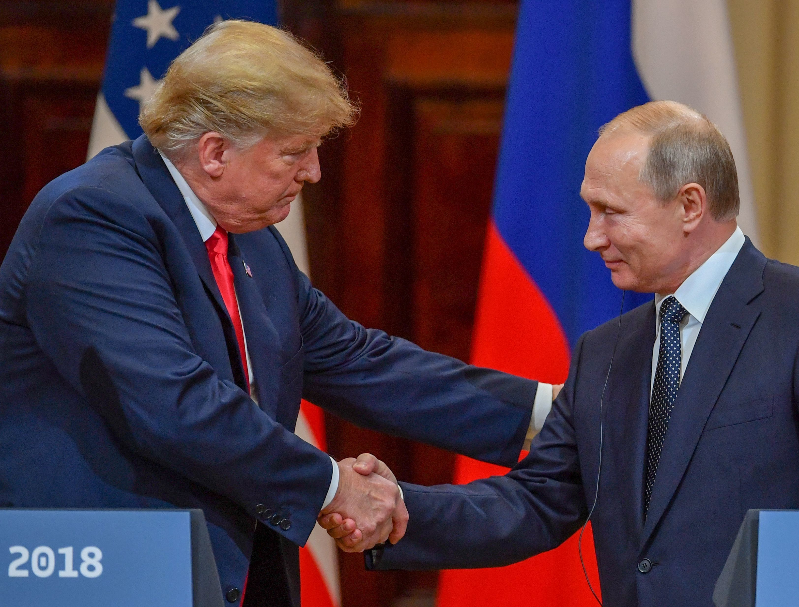 Donald Trump and Vladimir Putin shake hands after a meeting in Helsinki, Finland, on July 16.