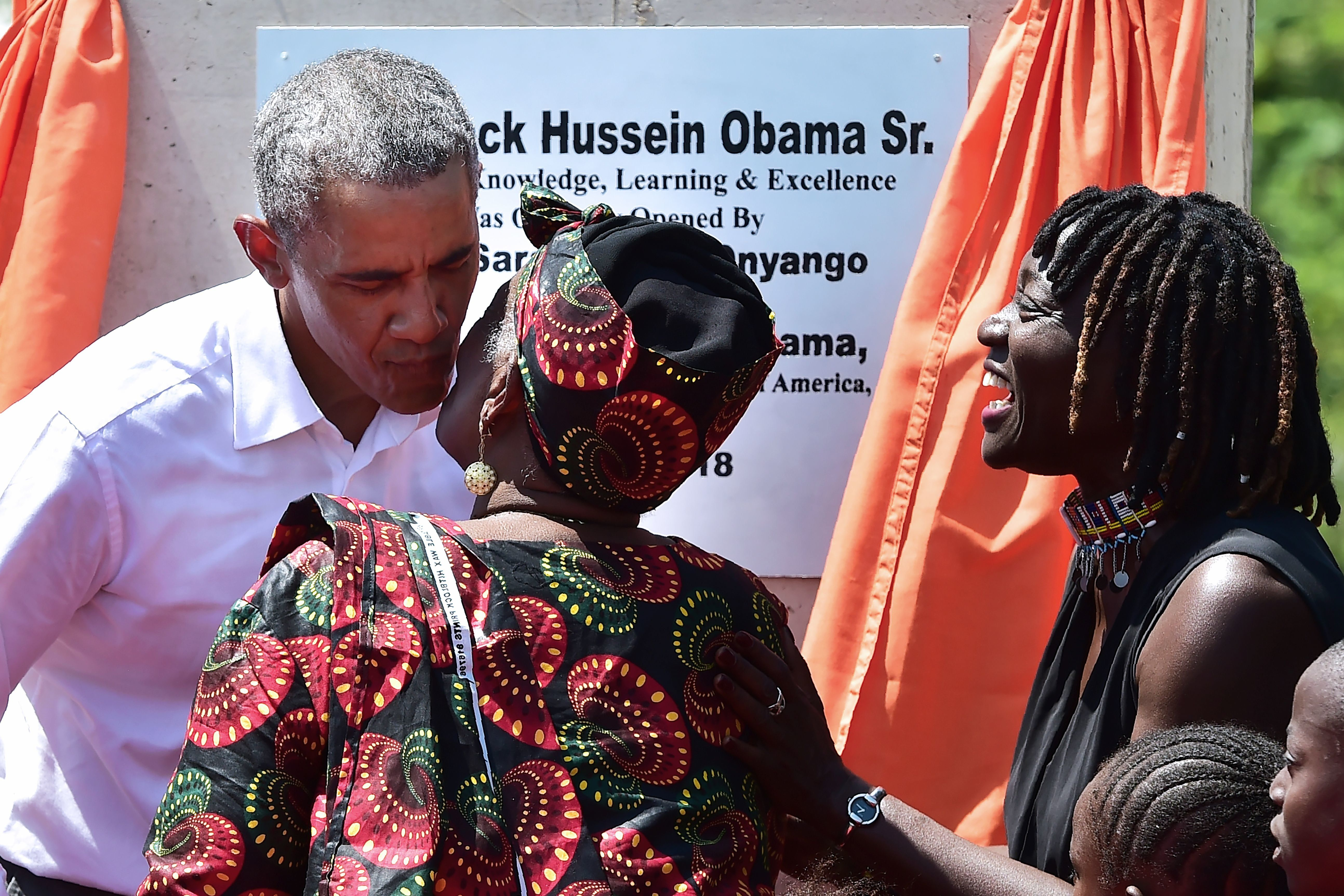 Former US President, Barack Obama (C) with his step-grandmother Sarah (2R) and half-sister, Auma (L) arrive to unveil a plaque on July 16, 2018 during the opening of the Sauti Kuu Resource Centre, founded by his half-sister, Auma Obama at Kogelo in Siaya county, western Kenya. - Obama is in the east african nation for the first time since he left the US presidency and met with President Uhuru Kenyatta and opposition leader Raila Odinga in Nairobi. (Photo by TONY KARUMBA / AFP)        (Photo credit should read TONY KARUMBA/AFP/Getty Images)