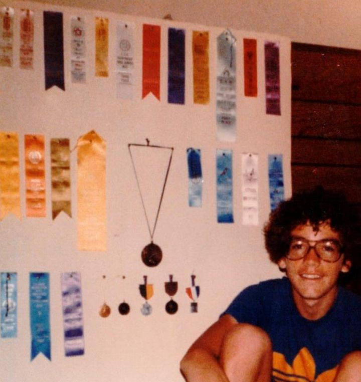 Steve Kissing in 1978 with some of the ribbons, medals and trophies he won for long-distance running, a sport he took up in an effort to beat the devil.