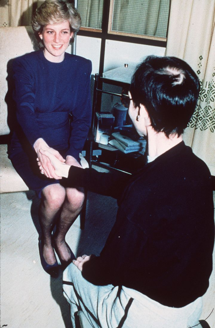 In this iconic 1987 image, Princess Diana shaking hands with an HIV-positive man at London's Middlesex Hospital.