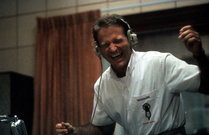"Robin Williams enjoying music through headset in a scene from the film ""Good Morning, Vietnam,"" 1987."