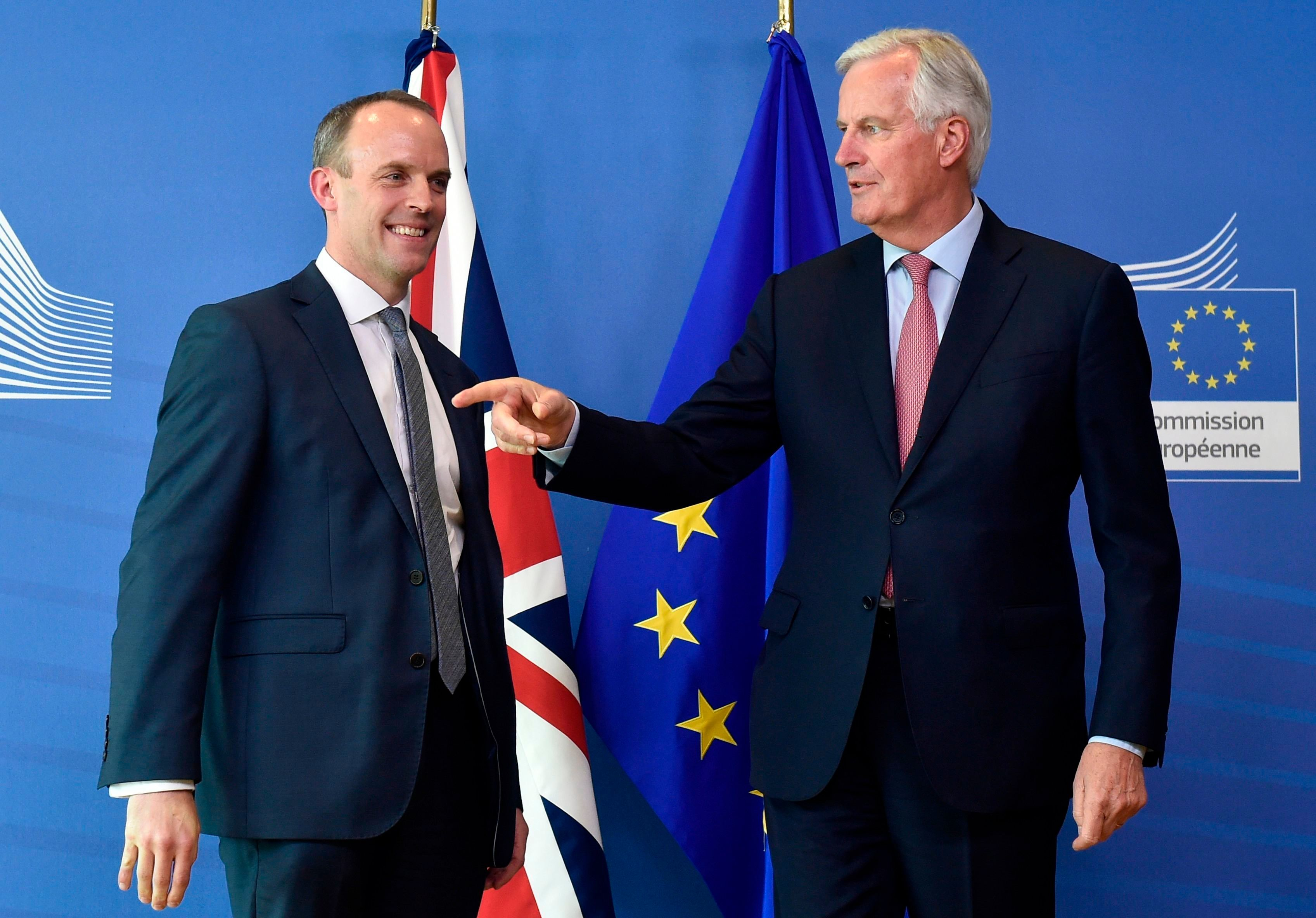 Dominic Raab with Michel Barnier in Brussels at their first