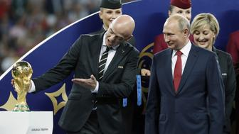 (L-R)  FIFA President Gianni Infantino, Russia President Vladimir Putin looking at the world cup trophy, FIFA World Cup during the 2018 FIFA World Cup Russia Final match between France and Croatia at the Luzhniki Stadium on July 15, 2018 in Moscow, Russia(Photo by VI Images via Getty Images)