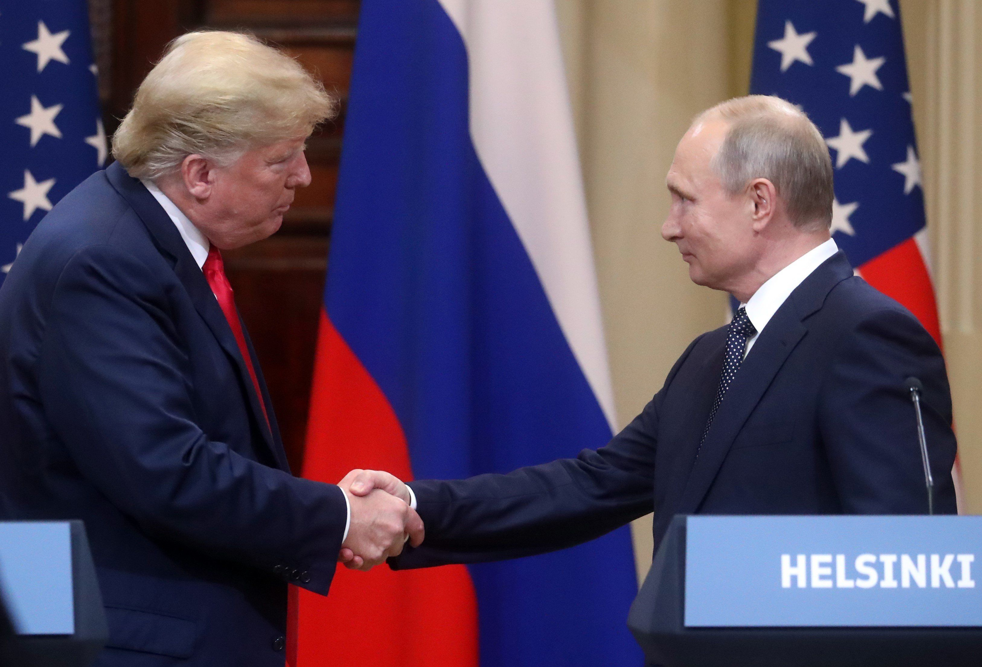 HELSINKI, FINLAND - JULY 16: U.S. President Donald Trump (L) and Russia's President Vladimir Putin (R) hold a joint press conference after their bilateral meeting in Helsinki, Finland on July 16, 2018.  (Photo by Stringer/Anadolu Agency/Getty Images)