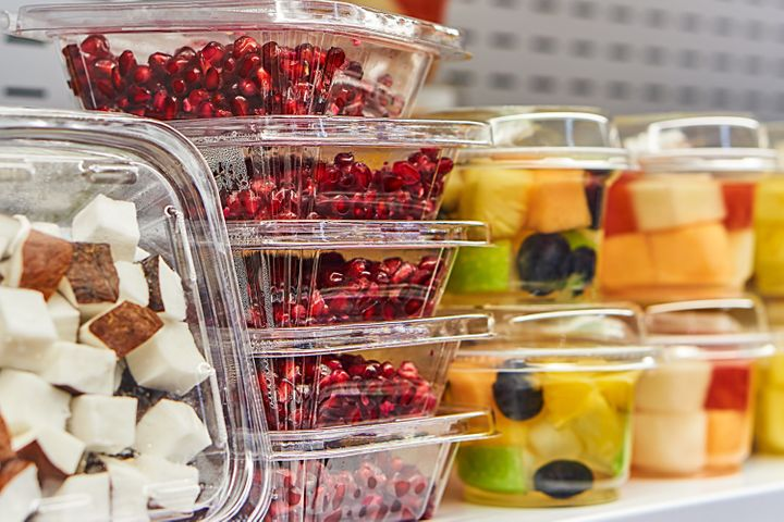 Cut fruit stored in plastic sits on store shelves. If we do nothing to slow down our consumption of plastic by 2050, the
