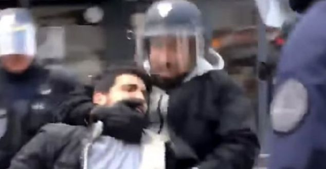 Alexandre Benalla  an aide to French President Emmanuel Macron is seen grabbing a protestor by the neck and chin