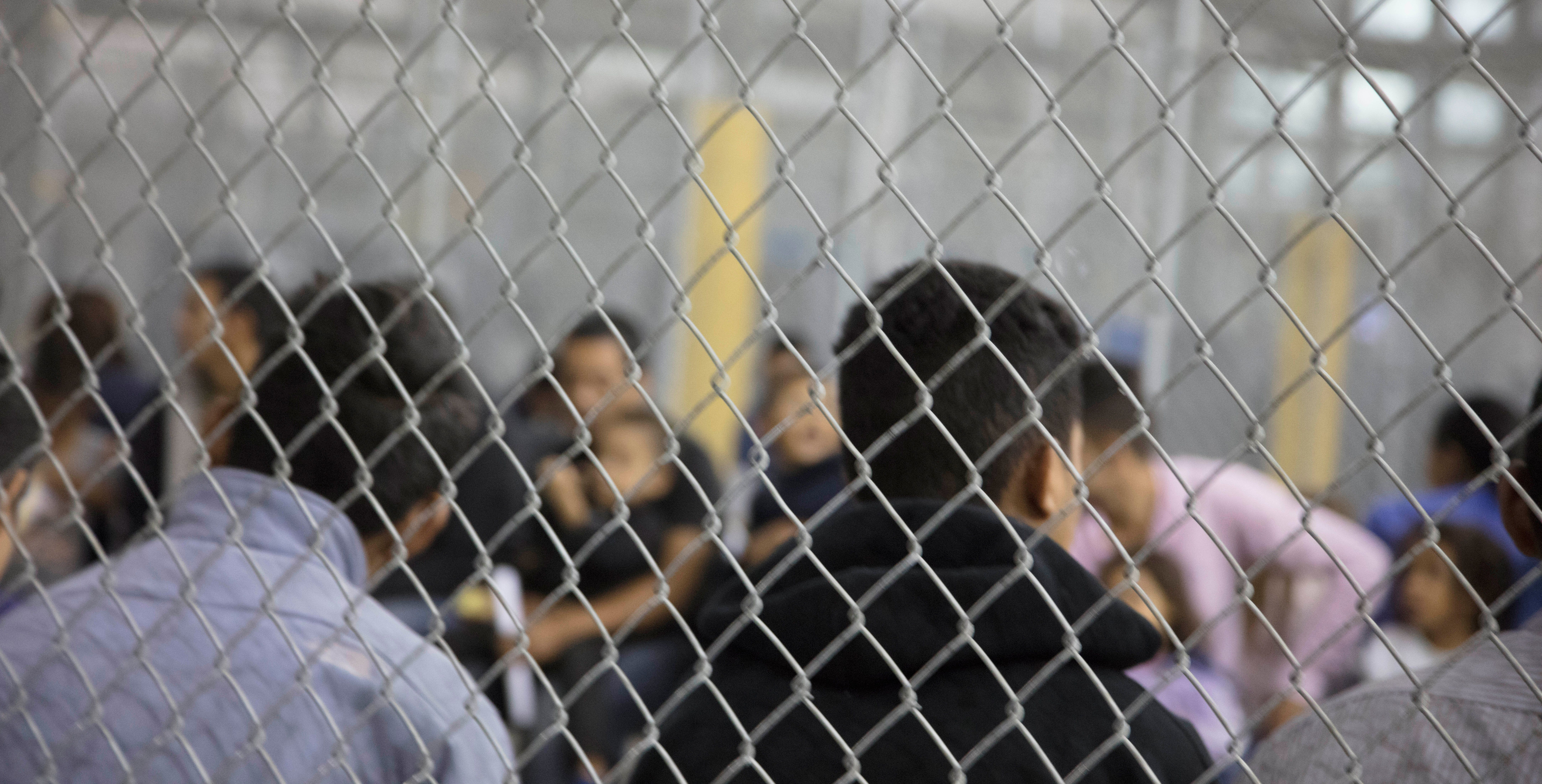 A view of inside U.S. Customs and Border Protection (CBP) detention facility shows detainees inside fenced areas at Rio Grande Valley Centralized Processing Center in Rio Grande City, Texas, U.S., June 17, 2018. Picture taken on June 17, 2018.   Courtesy CBP/Handout via REUTERS   ATTENTION EDITORS - THIS IMAGE HAS BEEN SUPPLIED BY A THIRD PARTY.