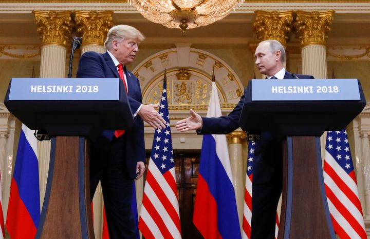 President Donald Trump and Russian President Vladimir Putin shake hands during a joint news conference after their meeting in