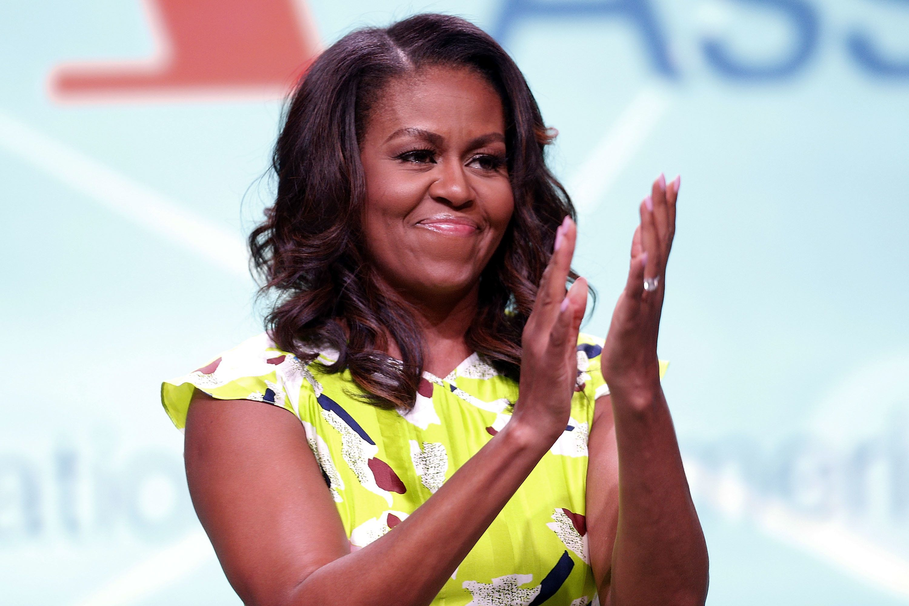 NEW ORLEANS, LA - JUNE 22:  Former U.S. first lady Michelle Obama waves after discussing her forthcoming memoir titled, 'Becoming', during the 2018 American Library Association Annual Conference on June 22, 2018 in New Orleans, Louisiana.  (Photo by Jonathan Bachman/Getty Images)