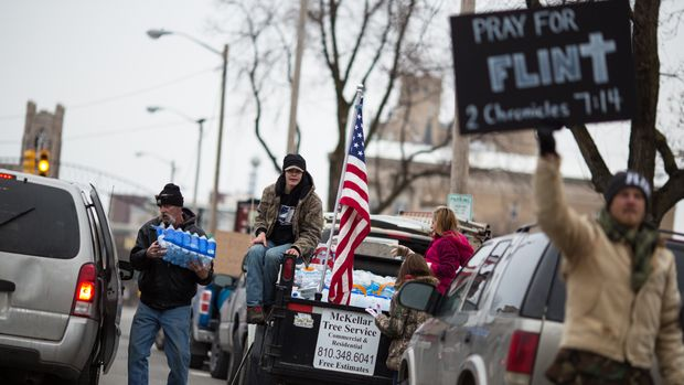 FLINT, MI - JANUARY 24:  Protestors hand out water to Flint residents during a rally on January 24, 2016 at Flint City Hall in Flint, Michigan.  The event was organized by Genesee County Volunteer Militia to protest corruption they see in government related to the Flint water crisis that resulted in a federal state of emergency.  (Photo by Brett Carlsen/Getty Images)
