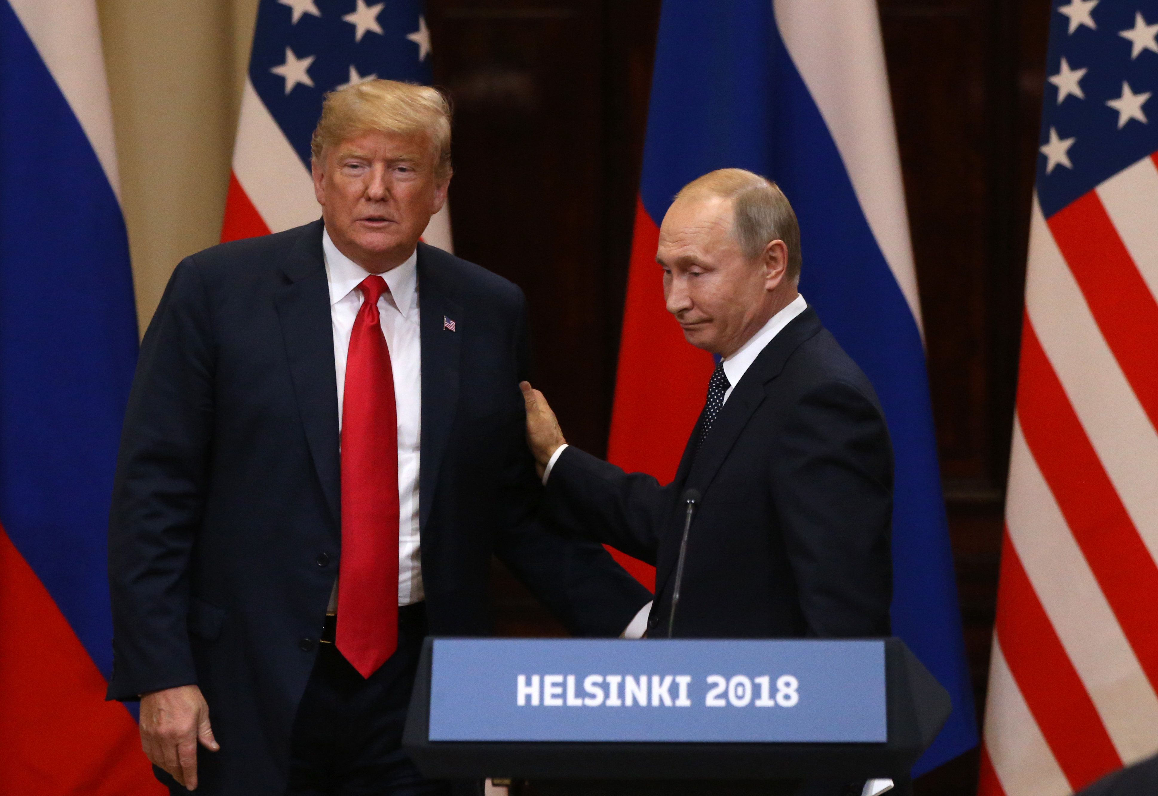 HELSINKI, FINLAND - JULY 16:  (RUSSIA-OUT) U.S. President Donald Trump (L) and Russian President Vladimir Putin attend a joint press conference after their summit on July 16, 2018 in Helsinki, Finland. The two leaders met one-on-one and discussed a range of issues including Russian meddling in the 2016 U.S election. (Photo by Mikhail Svetlov/Getty Images)