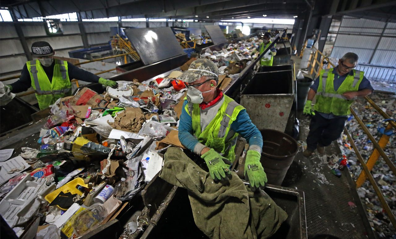 Trash is separated on a conveyor belt at E.L. Harvey & Sons in Westborough, Massachusetts, on May 31. The company says it's been forced to stockpile thousands of tons of recyclables since January.