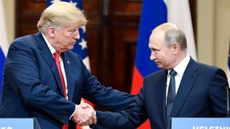 BEIJING, July 17, 2018  -- U.S. President Donald Trump (L) shakes hands with Russian President Vladimir Putin during a joint press conference in Helsinki, Finland, on July 16, 2018. (Xinhua/Lehtikuva/Jussi Nukari) (Xinhua/Lehtikuva/Jussi Nukari via Getty Images)