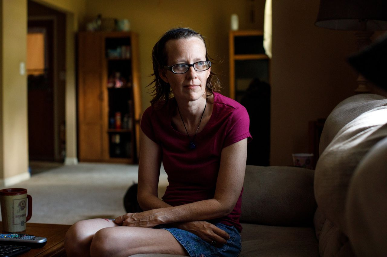 Meredith Lawrence sits in the living room of the home in Gainesville, Georgia, that she bought after her husband's death.