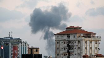 Smoke rises following an Israeli air strike in Gaza City July 20, 2018. REUTERS/Ahmed Zakot