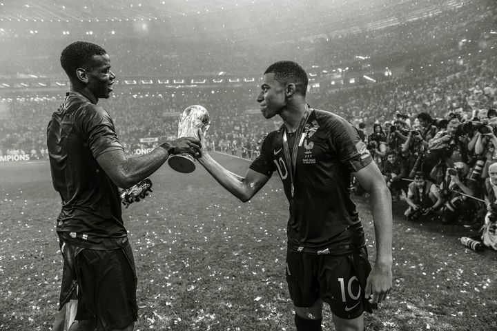 Paul Pogba and Kylian Mbappe of France celebrate winning the World Cup on July 15, 2018, in Moscow.