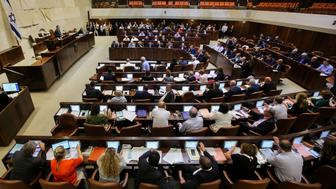 TOPSHOT - Israeli members of parliament attend the Knesset Plenary Hall session ahead of the vote on the National Law which speaks of Israel as the historic homeland of the Jews and says they have a 'unique' right to self-determination there, late on July 18, 2018. - Israel's parliament adopted a law defining the country as the nation state of the Jewish people, provoking fears it could lead to blatant discrimination against Arab citizens. (Photo by MARC ISRAEL SELLEM / AFP) / Israel OUT        (Photo credit should read MARC ISRAEL SELLEM/AFP/Getty Images)
